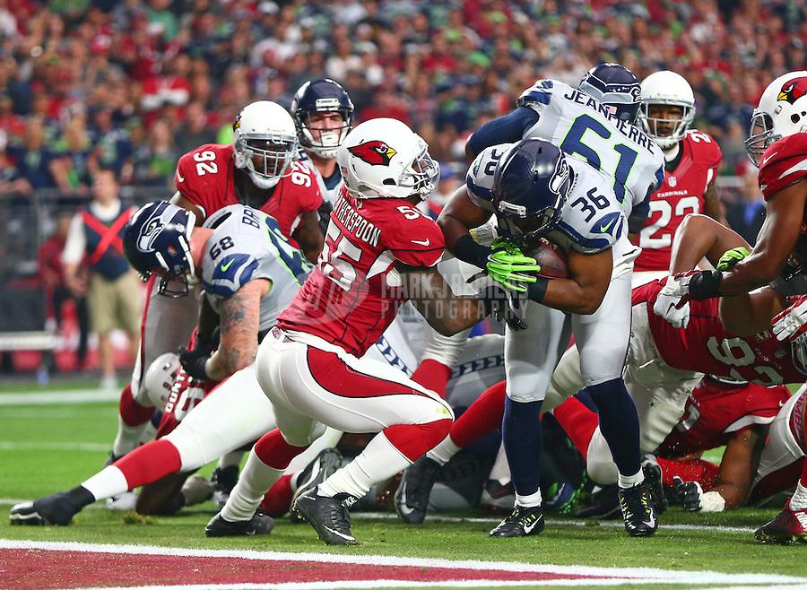 Jan 3, 2016; Glendale, AZ, USA; Seattle Seahawks running back Bryce Brown (36) pushes past Arizona Cardinals linebacker Sean Weatherspoon (55) for a first quarter touchdown at University of Phoenix Stadium. Mandatory Credit: Mark J. Rebilas-USA TODAY Sports
