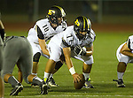 Torrance, CA 09/19/15 - Daniel Schubert (Peninsula #18) and Angel Maya (Peninsula #77) in action during the Peninsula Panthers - Torrance Tartars Varsity football game at Torrance High School
