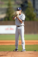 Florida Atlantic Owls starting pitcher Kyle Miller (17) looks to his catcher for the sign against the Charlotte 49ers at Hayes Stadium on March 14, 2015 in Charlotte, North Carolina.  The Owls defeated the 49ers 8-3 in game one of a double header.  (Brian Westerholt/Four Seam Images)
