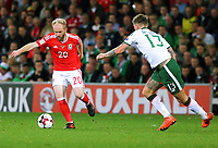 (L-R) Jonathan Williams of Wales is chased by Jeff Hendrick of Ireland during the FIFA World Cup Qualifier Group D match between Wales and Republic of Ireland at The Cardiff City Stadium, Wales, UK. Monday 09 October 2017