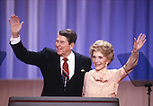 United States President Ronald Reagan and first lady Nancy Reagan wave from the podium of the 1988 Republican Convention as they acknowledge their supporters at the Super Dome in New Orleans, Louisiana on August 15, 1988.<br /> Credit: Arnie Sachs / CNP