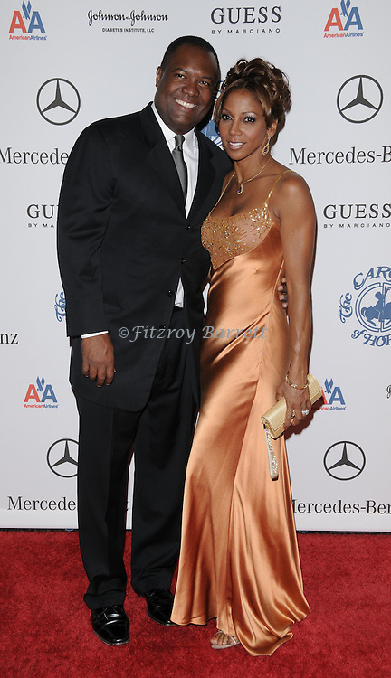 Holly Robinson Peete and husband Rodney Peete arriving at the 30th Anniversay Carousel Of Hope Ball benefiting the Barbara Davis Center for childhood diabetes, held at the Beverly Hilton Hotel Beverly Hills, Ca. October 25, 2008. Fitzroy Barrett