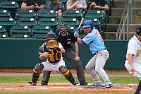 Tennessee Smokies designated hitter Willson Contreras (40) at bat in front of catcher Justin O'Conner and umpire Alex Ransom  during a game against the Montgomery Biscuits on May 25, 2015 at Riverwalk Stadium in Montgomery, Alabama.  Tennessee defeated Montgomery 6-3 as the game was called after eight innings due to rain.  (Mike Janes/Four Seam Images)