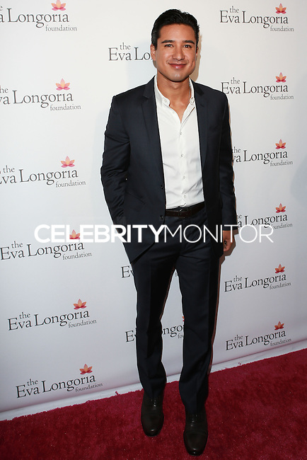 HOLLYWOOD, LOS ANGELES, CA, USA - OCTOBER 09: Mario Lopez arrives at the Eva Longoria Foundation Dinner held at Beso Restaurant on October 9, 2014 in Hollywood, Los Angeles, California, United States. (Photo by David Acosta/Celebrity Monitor)