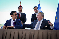 Pictured: (Top L-R) Prime Minister for FYROM Zoran Zaevat, Greek Prime Minister Alexis Tsipras (Front L-R), Nikola Dimitrov Minister of Foreign Affairs of FYROM and Greek foreign minister Nikos Kotzias at Prespa Lake in northern Greece. Sunday 17 June 2018 <br /> Re: Greece and the Former Yugoslav Republic Of Macedonia (FYROM) have signed a deal that aims to settle a decades-long dispute over the country's name.<br /> Under the agreement, Greece's neighbour will be known as North Macedonia.<br /> Heated rows over Macedonia's name have been going on since the break-up of the former Yugoslavia, of which it was a part, and have held up Macedonia's entry to Nato and the EU.<br /> Greece has long argued that by using the name Macedonia, its neighbour was implying it had a claim on the northern Greek province also called Macedonia.<br /> The two countries' leaders, Mr Tsipras and his Macedonian counterpart Zoran Zaev announced the deal on Tuesday and have pressed ahead despite protests.<br /> The two countries' foreign ministers signed the deal on Lake Prespa on Greece's northern border on Sunday.<br /> The agreement still needs to be approved by both parliaments and by a referendum in Macedonia.