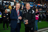Swansea City chairman Trevor Birch gives an award to Alan Curtis, assistant coach for Swansea City during the Sky Bet Championship match between Swansea City and Derby County at the Liberty Stadium in Swansea, Wales, UK. Wednesday 01 May 2019