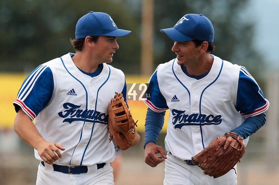25 july 2010: Starting pitcher Samuel Meurant of France runs back to the dugout next to Florian Peyrichou as he pitches against Czech Republic during France 6-1 victory over Czech Republic, in day 3 of the 2010 European Championship Seniors, in Neuenburg, Germany.