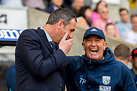 Manager of Swansea City, Paul Clement and Manager of West Bromwich Albion, Tony Pulis greet each other ahead of the Premier League match between Swansea City and West Bromwich Albion at The Liberty Stadium, Swansea, Wales, UK. Sunday 21 May 2017 (Photo by Athena Pictures/Getty Images)