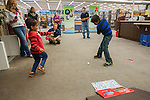 Sohan Vadlakunta attempts a ramp shot during the Mini Golf Night at the Carson City Library on Friday May 9, 2014. Kids and parents built a custom mini golf course throughout the library using anything at their disposal and engineering ideas to make a difficult course. Everything from tables to shelves were used to create creative courses.<br />