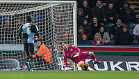 Goalkeeper Ryan Allsop of Wycombe Wanderers pulls off a fine save during the Sky Bet League 2 match between Wycombe Wanderers and Luton Town at Adams Park, High Wycombe, England on 6 February 2016. Photo by Andy Rowland.