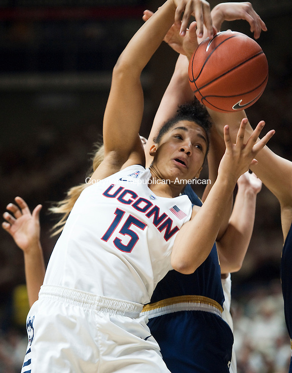 STORRS, CT--- -12015JS02--UConn's Gabby Williams (15) tries to pull down a rebound during their game against Notre Dame Saturday at Gampel Pavilion in Storrs. <br /> Jim Shannon Republican-American