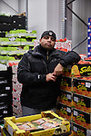 BERLIN 12.2016. German Wrestler RAMBO MICHEL BRAUN alias EL COMANDANTE RAMBO at work. Rambo works at Berliner Großmarkt for LYKOS selling Greek groceries and restaurant apparel.<br /><br />Other trainers are: Crazy Sexy mike (Hussein Chaer, man with headband) and Ahmed Chaer (man with beard) (Photo by Gregor Zielke)