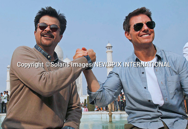 "TOM CRUISE.fufils his wish to visit the Taj Mahal monument in Agra, India..He was accompanied by Bollywood Actor (""Slumdog Millionaire"") Anil Kapoor..Tom Cruise is in India to promote Mission Impossible 4_Agra, India_03/12/2011.Mandatory Photo Credit: ©Solaris Images/NEWSPIX INTERNATIONAL..**ALL FEES PAYABLE TO: ""NEWSPIX INTERNATIONAL""**..PHOTO CREDIT MANDATORY!!: NEWSPIX INTERNATIONAL(Failure to credit will incur a surcharge of 100% of reproduction fees)..IMMEDIATE CONFIRMATION OF USAGE REQUIRED:.Newspix International, 31 Chinnery Hill, Bishop's Stortford, ENGLAND CM23 3PS.Tel:+441279 324672  ; Fax: +441279656877.Mobile:  0777568 1153.e-mail: info@newspixinternational.co.uk"
