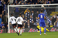 Fulham's Moussa Dembele misses a penalty as he chips the ball over the crossbar