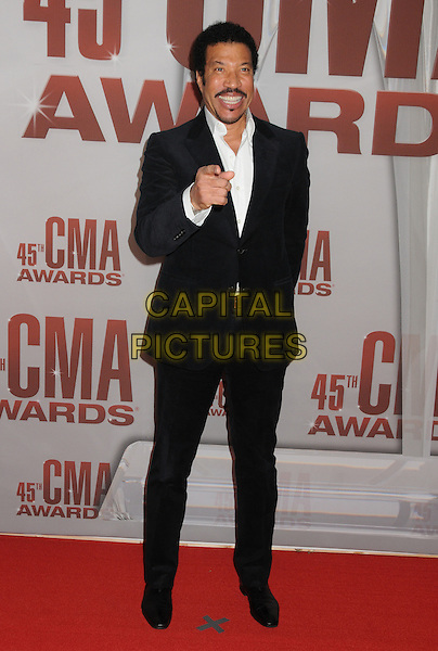 Lionel Richie.The 45th Annual CMA Awards, Country Music's Biggest Night, held at Bridgestone Arena, Nashville, Tennessee, USA..November 9th, 2011.full length black suit jacket white shirt goatee facial hair hand pointing .CAP/ADM/BP.©Byron Purvis/AdMedia/Capital Pictures.