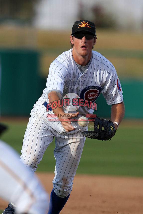 Mesa Solar Sox infielder D.J. LeMahieu #7 flips the ball to the pitcher covering first during an Arizona Fall League game against the Phoenix Desert Dogs at HoHoKam Park on November 3, 2011 in Mesa, Arizona.  Mesa defeated Phoenix 8-7.  (Mike Janes/Four Seam Images)