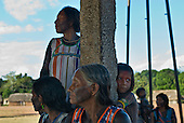 Pará State, Brazil. Aldeia Kikretum. Djope Kayapó, women watch arrival of the health visitor.