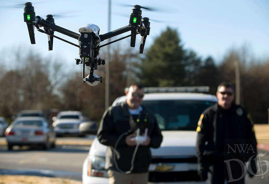 NWA Democrat-Gazette/JASON IVESTER<br /> Rogers Police Sgt. Miles Mason (right) watches as Cpt. Jarod Mason flies the department's DJI Inspire 1 v2.0 quadcopter on Monday, Dec. 19, 2016, behind the Rogers Police Department.