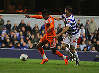 FAO SPORTS PICTURE DESK<br /> Pictured L-R: Scott Sinclair of Swansea challenged by Clint Hill of QPR. Wednesday, 11 April 2012<br /> Re: Premier League football, Queens Park Rangers v Swansea City FC Loftus Road Stadium, London.