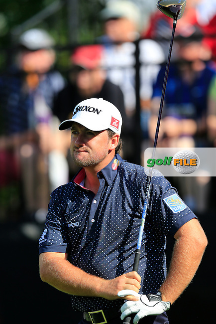 Graeme McDowell (NIR) tees off the 10th tee to start his match during Thursday's Round 1 of the 2013 Bridgestone Invitational WGC tournament held at the Firestone Country Club, Akron, Ohio. 1st August 2013.<br /> Picture: Eoin Clarke www.golffile.ie