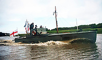 BNPS.co.uk (01202 558833)<br /> Pic: RobertMorley/BNPS.<br /> <br /> Out of the shadows - the fully restored craft.<br /> <br /> The world's first drone boat is rediscovered - after 100 years in the shadows.<br /> <br /> A historic British torpedo boat, which was converted into the world's first remotely controlled 'drone vessel' as part of a top secret project at the end of the Great War has been painstakingly researched and restored after being discovered rotting in a West country boatyard.<br /> <br /> The pioneering CMB9/DCB1 was one of 12 Coastal Motor Boats (CMBs) built by the Admiralty in 1916 to target German destroyers.<br /> <br /> The fast, lightweight 40ft motor torpedo boat, which could travel at 40 knots, sunk the German destroyer G88 off Zebrugge in Belgium in 1917.<br /> <br /> Subsequently, it was one of four vessels converted into Distance Control Boats (DCBs) for top secret trials to see if unmanned patrol boats with torpedoes could be radio controlled via aircraft and directed towards enemy targets.<br /> <br /> The boat was found in a sorry state covered in brambles in a boat yard in Weston-super-Mare, Somerset, by marine surveyor Robert Morley a decade ago, who has spent tens of thousands of pounds restoring and researching it's colourful history.