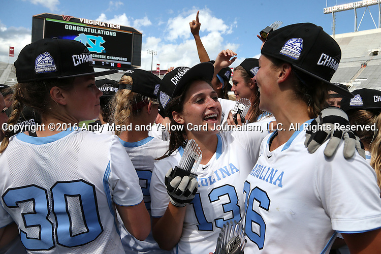 01 May 2016: North Carolina's Sammy Jo Tracy (13), Kelly Devlin (26), and Alex Moore (30) celebrate after the game. The University of North Carolina Tar Heels played the Syracuse University Orange at Lane Stadium in Blacksburg, Virginia in the 2016 Atlantic Coast Conference Women's Lacrosse Tournament championship match. North Carolina won 15-14 in overtime.