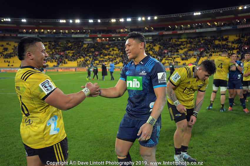 Asofa Aumua and Caleb Clarke shake hands after the Super Rugby match between the Hurricanes and Blues at Westpac Stadium in Wellington, New Zealand on Saturday, 15 June 2019. Photo: Dave Lintott / lintottphoto.co.nz