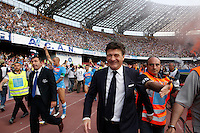 Napoli's  coach Walter Mazzarri   celebrates victory and the qualification of the SSC Napoli team in the UEFA Champions League during the Italian Serie A football match between SSC Napoli and Siena at the San Paolo stadium in Naples.NAPOLI CACIO FESTA QUALIFICAZIONE  CHAMPIONS
