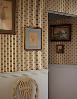 In true 18th-century style, a jib door opens into one of the bedrooms, concealed behind richly patterned wallpaper and antique artwork