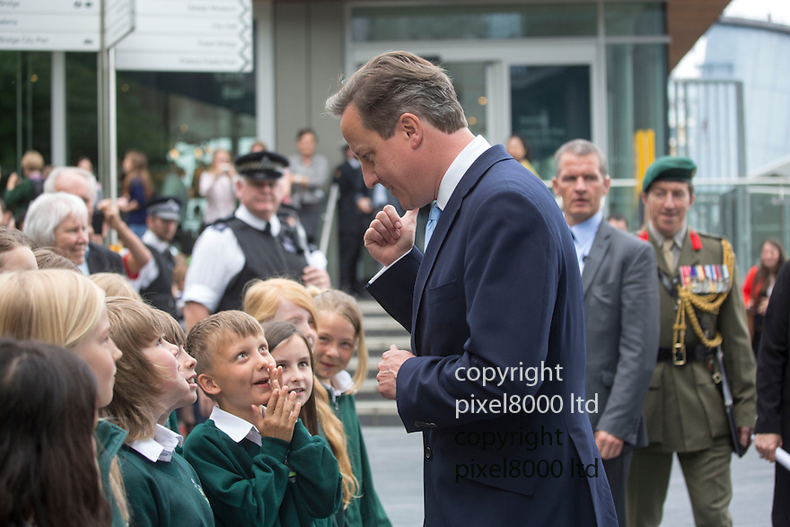 Prime Minister David Cameron meets children from St Nicholas School in Tillingham, Essex after disembarking from the HMS Belfast today  20.5.14<br /> <br /> <br /> <br /> <br /> Pic by Gavin Rodgers/Pixel 8000 Ltd