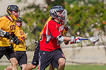 Los Angeles, CA 02/15/14 - Jack Gilchrist (USC #11) and Daniel Maxwell (Utah #10) in action during the Utah versus USC game as part of the 2014 Pac-12 Shootout at UCLA.  Utah defeated USC 10-9.