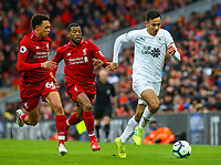 Burnley's Dwight McNeil gets away from Liverpool's Georginio Wijnaldum and Trent Alexander-Arnold<br /> <br /> Photographer Alex Dodd/CameraSport<br /> <br /> The Premier League - Liverpool v Burnley - Sunday 10th March 2019 - Anfield - Liverpool<br /> <br /> World Copyright © 2019 CameraSport. All rights reserved. 43 Linden Ave. Countesthorpe. Leicester. England. LE8 5PG - Tel: +44 (0) 116 277 4147 - admin@camerasport.com - www.camerasport.com
