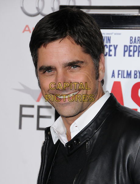 "JOHN STAMOS .attends the AFI Fest 2010 presented by Audi Centerpiece Gala screening of ""Casino Jack"" held at The Grauman's Chinese Theatre in Hollywood, California, USA, November 8th 2010..portrait headshot white shirt black leather smiling                                                                  .CAP/RKE/DVS.©DVS/RockinExposures/Capital Pictures."