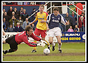 26/04/2003                   Copyright Pic : James Stewart.File Name : stewart-falkirk v ayr 07.CRAIG NELSON SAVES AT THE FEET OF STUART TAYLOR......James Stewart Photo Agency, 19 Carronlea Drive, Falkirk. FK2 8DN      Vat Reg No. 607 6932 25.Office     : +44 (0)1324 570906     .Mobile  : +44 (0)7721 416997.Fax         :  +44 (0)1324 570906.E-mail  :  jim@jspa.co.uk.If you require further information then contact Jim Stewart on any of the numbers above.........