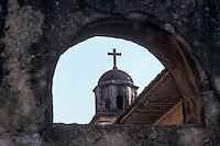 Steeple of the Templo del Sagrario framed by an arch,  Patzcuaro, Michoacan, Mexico
