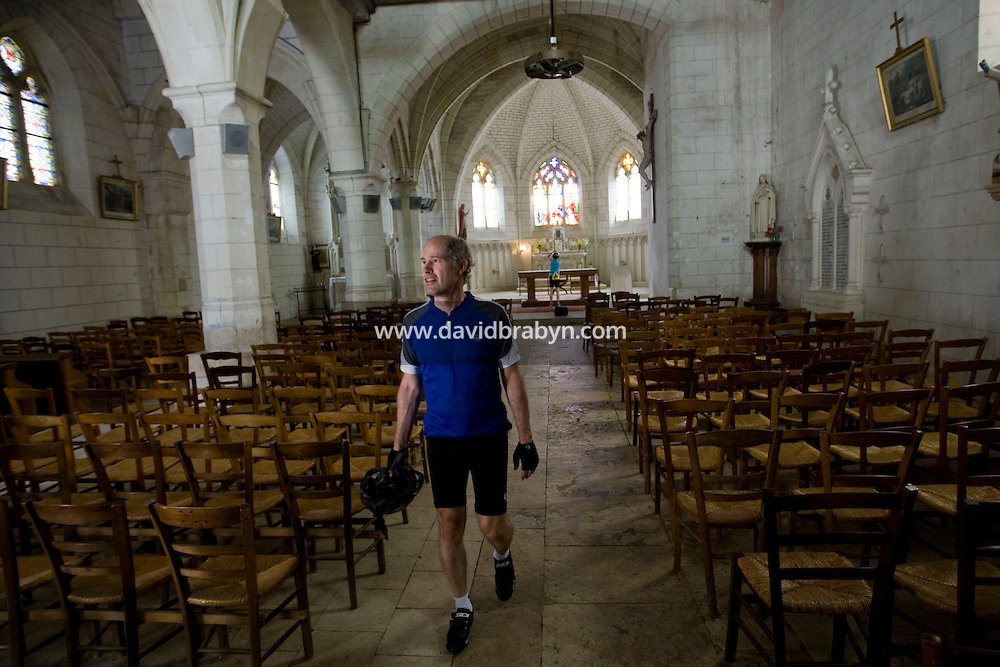Writer David Darlington, participating in a Backroads cycle tour of the Loire Valley, cycles towards Athee-sur-Cher, France, 25 June 2008.