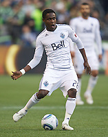 Vancouver Whitecaps FC  forward Gershon Koffie passes the ball during play against the Seattle Sounders FC at Qwest Field in Seattle Saturday June 11, 2011. The game ended in a 2-2 draw.