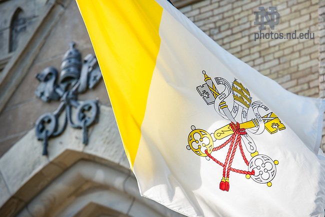 August 15, 2017; Papal flag and coat of arms outside the Basilica of the Sacred Heart. (Photo by Matt Cashore/University of Notre Dame)