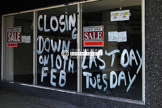 The windows of a closed shop. UK