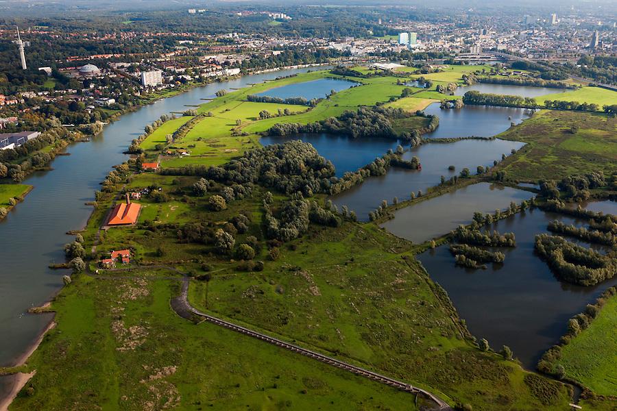 Nederland, Gelderland, Gemeente Arnhem, 03-10-2010; zicht op Meinerswijk, naar het westen, links de bebouwing van Arnhem. In de voorgrond het regelwerk (doorlaatwerk met schuiven), onderdeel van de voormalige IJssellinie. Ter hoogte van de oude steenfabriek (met rood pannendak) kon de rivier door middel van drijvende stuw afgesloten worden.. In het kader van het programma Ruimte voor de Rivier zullen delen van de uiterwaard afgraven worden. Ook zal het gebied opnieuw ingericht worden..View of floodplains and polder Meinerswijk, Arnhem to the left. In the foreground control works (operating with slides) part of the former IJssel defense line. The area will partly excavated to create 'space for the river'.  .luchtfoto (toeslag), aerial photo (additional fee required).foto/photo Siebe Swart
