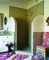 The bathroom's open shower is lined with made-to-order Moroccan tiles