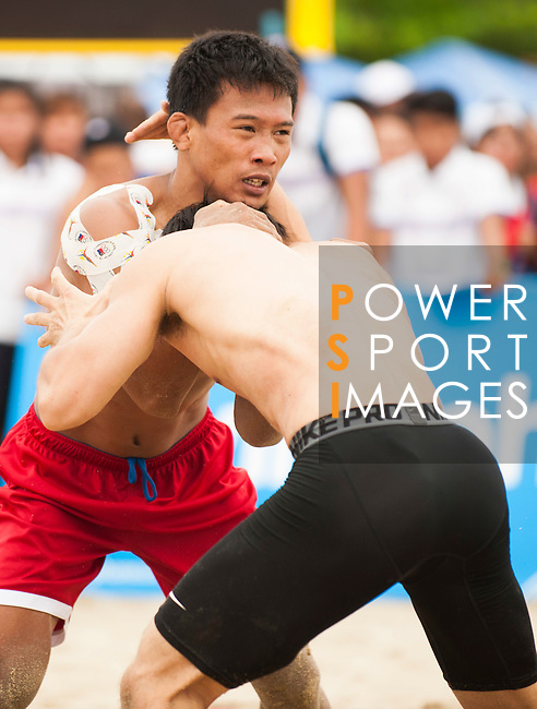 Wrestlers compete during the Beach Wrestling Men's competition between Korea and Philippines on Day Eight of the 5th Asian Beach Games 2016 at Bien Dong Park on 01 October 2016, in Danang, Vietnam. Photo by Marcio Machado / Power Sport Images
