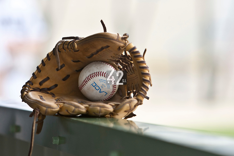 21 May 2009: A glove and a ball are seen in the dugout during the 2009 challenge de France, a tournament with the best French baseball teams - all eight elite league clubs - to determine a spot in the European Cup next year, at Montpellier, France.