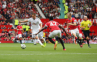 Pictured L-R: Gylfi Sigurdsson of Swansea and Tyler Blackett of Manchester United.  Saturday 16 August 2014<br />