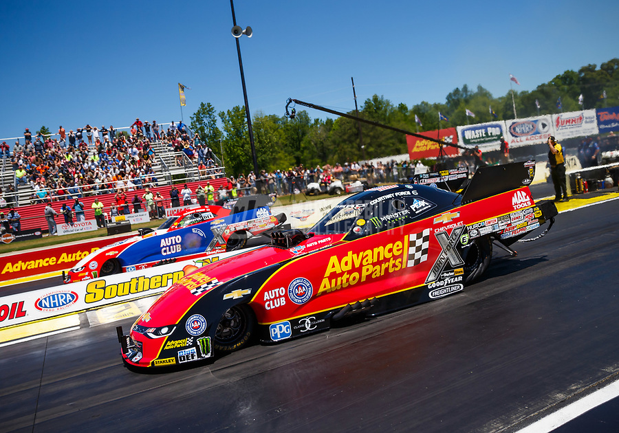 May 7, 2017; Commerce, GA, USA; NHRA funny car driver Courtney Force (near) races alongside Robert Hight during the Southern Nationals at Atlanta Dragway. Mandatory Credit: Mark J. Rebilas-USA TODAY Sports