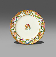 BNPS.co.uk (01202 558833)<br /> Pic: Woolley&Wallis/BNPS<br /> <br /> £15,000 - Sevres porcelain plate from the collection of Madame du Barry bearing her DB initials<br /> <br /> One woman's lifetime collection of French porcelain that filled 'every nook and cranny' of her modest home sold for £373,000 yesterday, over £125,000 over estimate.<br /> <br /> The late Judith Howard's passion for 18th century gallic ceramics saw the walls, shelves and display cabinets adorned with hundreds of plates, dishes and bowls.<br /> <br /> She was well known for having an eye for a bargain, so much so that a 250-year-old plate she bought for £13 at an antiques shop sold for £31,000.<br /> <br /> The item was once part of the 1,735 dinner service set made for French King Louis XV and housed in the Palace of Versailles.