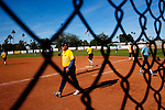 Members of the Daily Sun News Softball Team walk onto the field as members of the VFW Post 10695 walk off during a game at the Sun City softball field Decmber 15, 2009. There are more than 20 softball teams in Sun City.