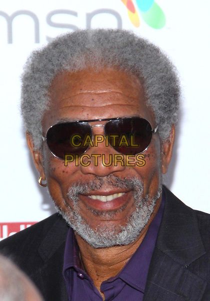 MORGAN FREEMAN .The Hollywood  Reporter Honoring Oscar Nominees  held at The Getty House,  Los Angeles, California, USA, 5th March 2010..portrait headshot grey gray beard facial hair smiling sunglasses aviators purple .CAP/ADM/TC.©T. Conrad/AdMedia/Capital Pictures.