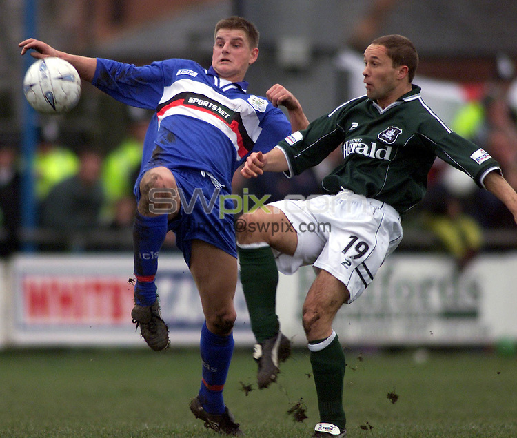 Pix, Shaun Flannery/SWpix. FA Cup First Round..Whitby Town v Plymouth Argyl, 17/11/2001..COPYRIGHT PICTURE>>SIMON WILKINSON>>01943 - 436649>>..Whitby's Graham Rennison challenges Plymouth's Marino Keith.