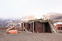 Rusting tanks are some of the remnants of the bygone whaling era left at an abandoned Norwegian whaling base in Whalers Bay on Deception Island, in the South Shetland Islands near the Antarctic Peninsula.